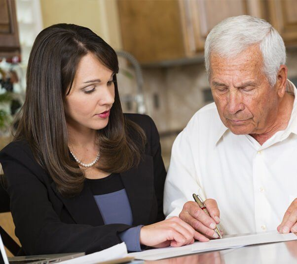 young woman helping an older man with probate paperwork