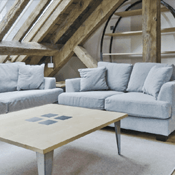 Roof trusses and sofas in converted loft