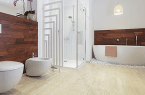 A white and wood effect bathroom