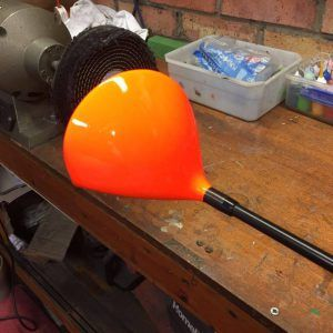 a orange golf club