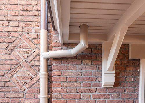 cream gutter on brick house
