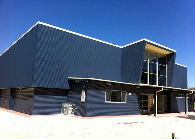 big blue modern angled building