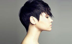Profile of a lady with short black pixie cut