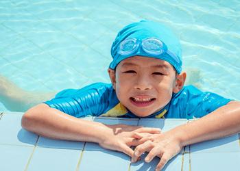 a kid in blue swim suit
