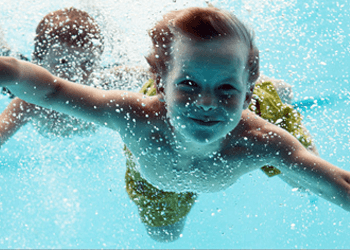 kids swimming under the water