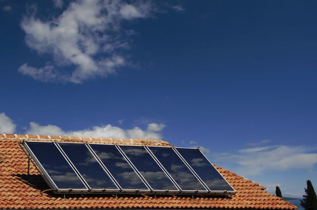 A solar hot water system being install in Wairarapa