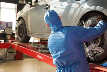 car being repaired by an expert