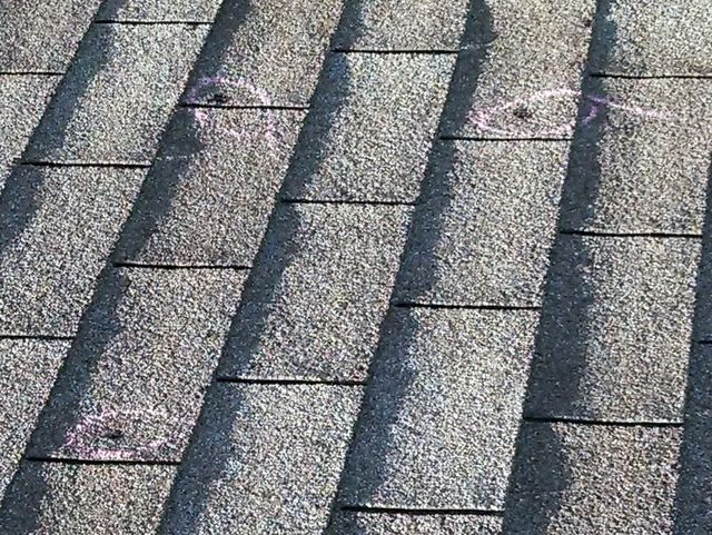 Composition shingles with hail damage