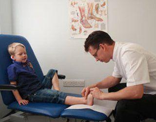 A little boy having a foot treatment