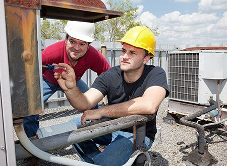 Team of workers provides air condition repair services in Talladega, AL