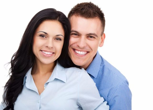 couple wearing blue smiling
