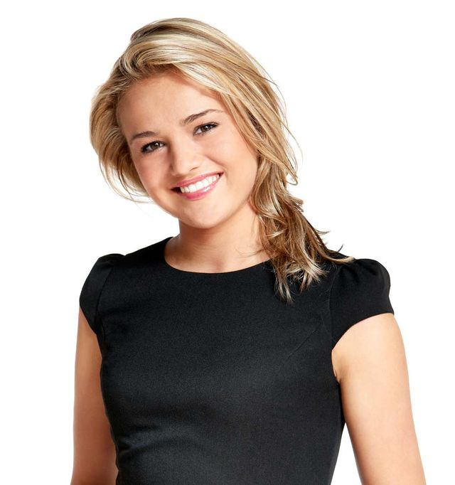 blonde woman with black shirt smiling