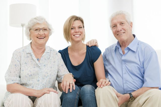 elderly couple with happy daughter after marriage counseling in Honolulu, HI
