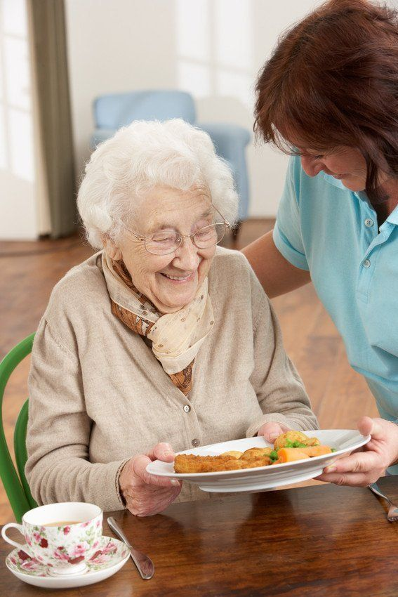 elderly lady and nurse in care home