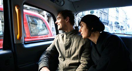 Couple inside a taxi