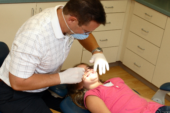 Patient undergoing teeth alignment service at Michael Mosling's office in La Crosse, WI