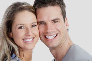 A smiling young couple showing white teeth