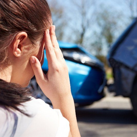 Woman who just crashed her car and needs auto body repair in Kalispell, MT