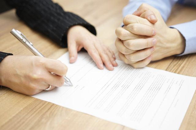 Attorney signing a contract with the client