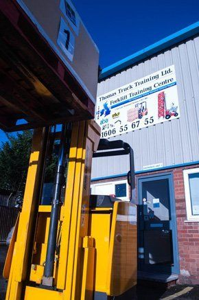 Image of man driving forklift at training centre