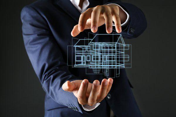 amministratore mostra modello in 3D di condominio