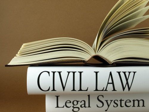 un libro e la scritta civil law legal system