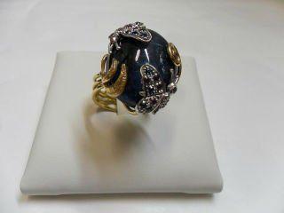 anello in oro con pietre preziose