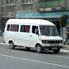 moving white minibus