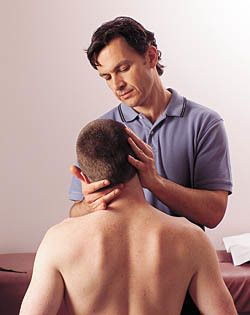 Dr Neff adjusting neck, Chiropractor at InMotion Health Center in St. Louis MO