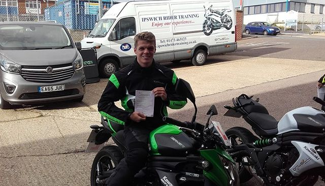 Bike Rider Showing the Certificate
