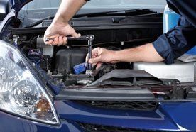 using a specialist wrench on a car engine