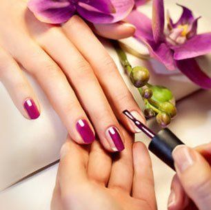 nail painting in deep purple