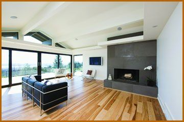 Flooring services - Slough, Buckinghamshire --Contemporary lounge with wooden floors - Wood Floor Renovations