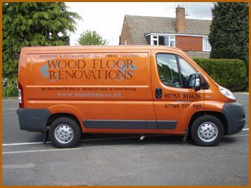 Flooring services - Slough, Buckinghamshire --Contemporary lounge with wooden floors - Wood Floor Renovations Van