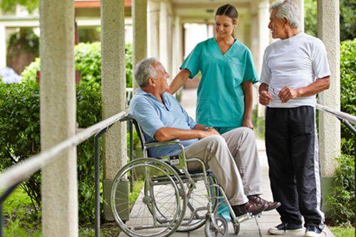 Skilled staff member interaction with elder people in a beautiful nursing home in Cincinnati, OH