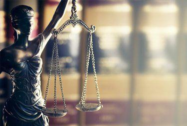 justice system scale sculpture