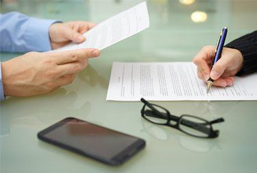 A client signing documents for family law in Noarlunga
