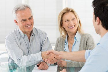 A lawyer meeting with clients about estates in Noarlunga