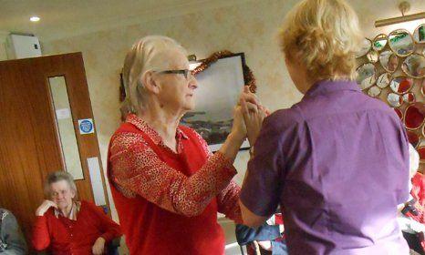 2 elderly ladies discussing