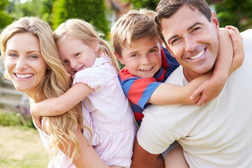 Healthy family happy after our treatments