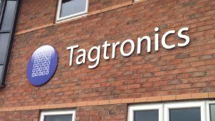 Exterior lettering on wall for Tagtronics