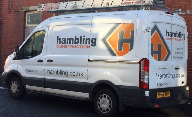 A white van with QH graphic