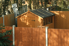 Fenced off garden with a shed