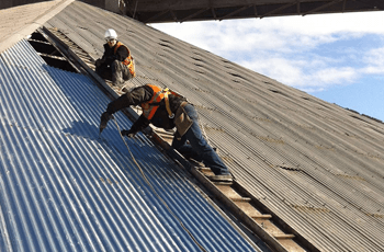 roofing experts at work