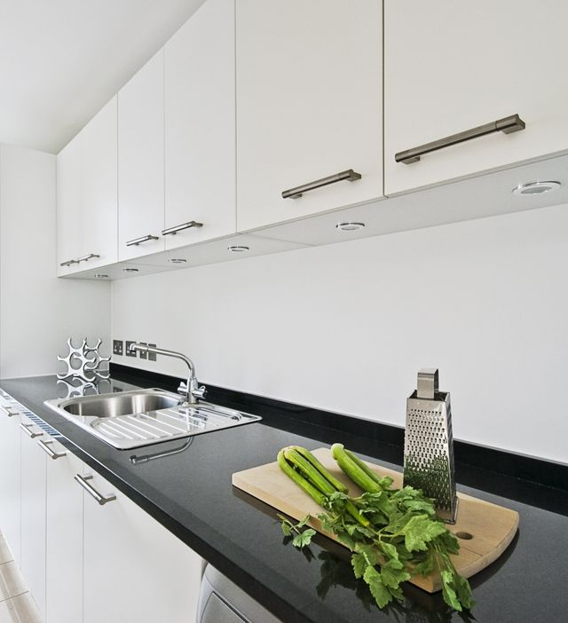 Come see our selection of granite, marble, and quartz countertops like this kitchen example, in Victoria BC