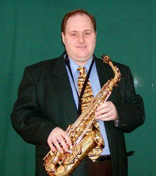 Photo of Mark with his saxophone