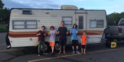 kids enjoying outside the caravan