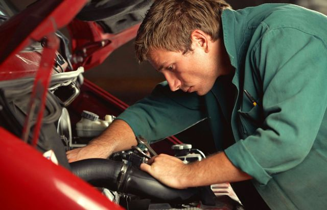 Mechanic replacing radiator hose in Christchurch