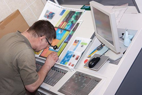 Printing specialist matching color for branding in Auckalnd