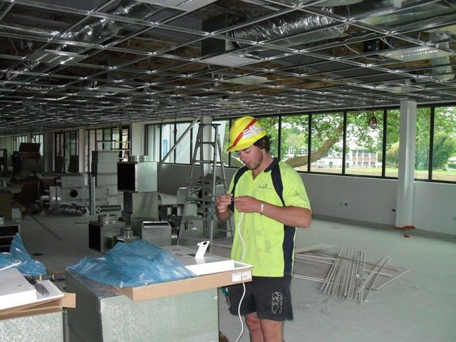 Commercial electrician installing electrical fit outs